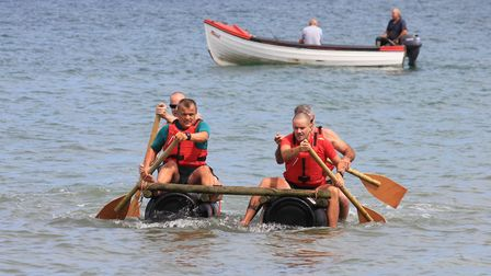 The Lobster staff team row for the shore.Photo: KAREN BETHELL