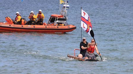 Lifeboat crew members Matt Blake and Lewis Gray, who were first to the finish line on their RNLI raf