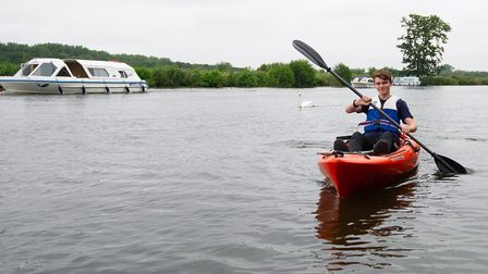 Will Darling litter-picking on his kayak on the Norfolk Broads. Pictures: Matthew Power Photography