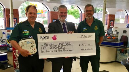 Wroxham Food Hall manager Darren Coles presents Stalham and Smallburgh First Responders Tim Thirst a