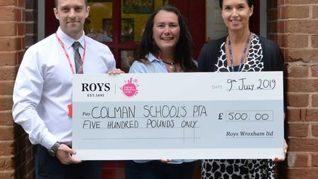 Bowthorpe store manager Dan Dicks presenting cheque to Susan Chedgey (Chairman of PTA) and Rachel Sm