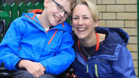 Nine-year-old Ben Taylor, who needs a life-changing, £60,000 operation, with his mum Belinda.Picture