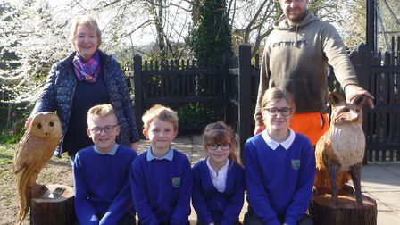 Kelling Primary School pupils on the bench donated in the memory of Joan Gray. Picture: Supplied by