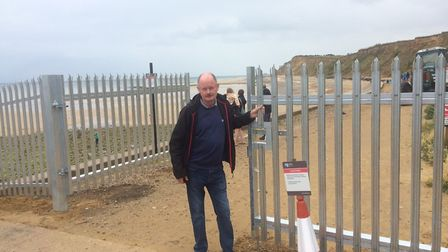 Nigel Turner, pictured, has criticised Mr Chambers for putting up the barrier at West Runton beach.