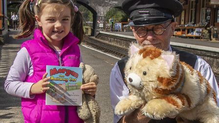 North Norfolk Railway volunteer David Parmenter with a young visitor to last year's family fun day s