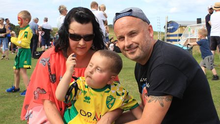 East Runton couple Julie and Kevin Pitcher with their five-year-old son Benny, who has a rare and ag