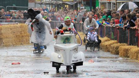 Competitors being pelted with flour and water in the waiters and waitresses' race. Photo: KAREN BETH
