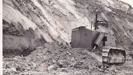 An armoured bulldozers at work at Trimingham in the autumn of 1953. The bulldozer is slicing away pa