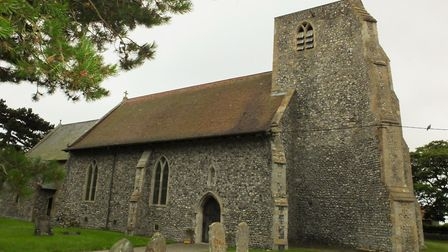 Saint John the Baptist's Head in Trimingham. The church features on the north Norfolk village's sign