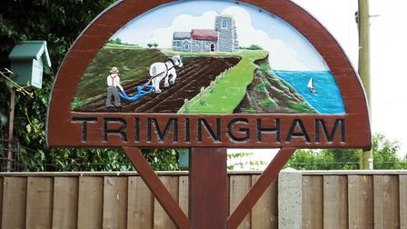 The village sign in Trimingham, Norfolk, showing it as a 'cliff-top farming village'. Picture: Dr An