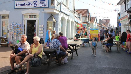 Sheringham shoppers enjoying a traffic-free High Street, which has been closed to vehicles since the