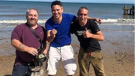 Toby Smith, far right, on Cart Gap beach, after his latest successful find. Picture: Toby Smith