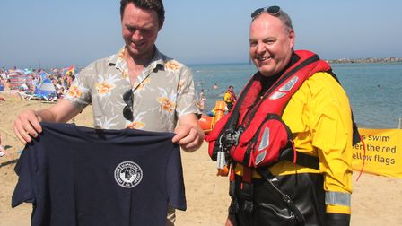 Mick Clarke, right, presents T-Shirt to Jonny McPherson. Pictures: Maurice Gray