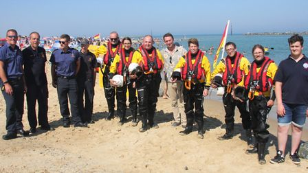 Jonny McPherson, fifth from right, welcomed by some of the crews. Pictures: Maurice Gray