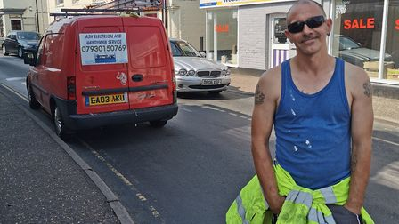 Tony Smith-Howell directing traffic in North Walsham. Pictures: supplied by Tony Howell-Smith