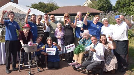 Staff and residents at Munhaven care home in Mundesley celebrate an outstanding CQC inspection with