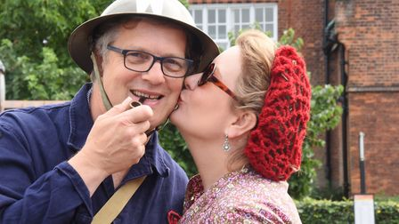 Warden Anthony Burn gets a cheeky kiss from his wife Carolyn as locals launch the Holt 1940's weeken
