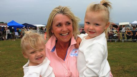 Glamorous grandmother entrant Linda Padmore with three-year-old twin granddaughters Orla and Annabel