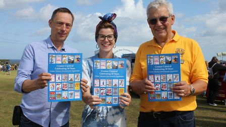 Cromer Carnival chairman Tony Shipp (right) launching a booklet marking the 50th annivarsary of the