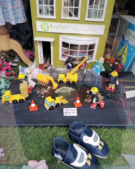 Sheringham's High Street shops have done their best to make light of the sinkhole. Heirloom toy shop