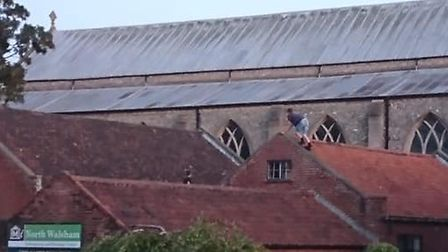 Two young males were seen climbing on the roof of this building in North Walsham. Picture: Davey Lee