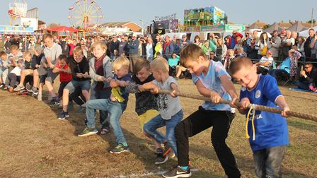 Young carnival-goers testing their strength in a boys vs girls tug-of-war contest at last year's Cro