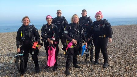 Polly Wake, fourth from left, with a group of divers kitted out in dry suits for a dive off the nort
