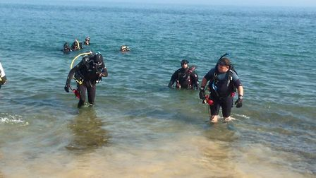 Divers emerge from a 'beach dive' off the north Norfolk Coast. Picture: Supplied by Cristal Seas Scu