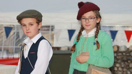 A couple of wartime evacuees watch the 1940s weekend military vehicle parade.Photo: KAREN BETHELL