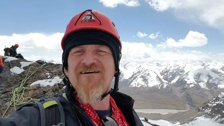 Toby Batch, from Norwich, on the summit a moutain in Kyrgyzstan which no-one had ever climbed before
