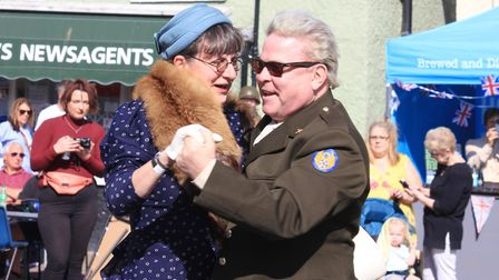 1980s icon David Van Day takes a festival-goer for a turn around the dancefloor at Holt's 1940s week