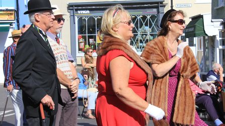 Forties festival-goers dancing to the strains of 1980s icon David Van Day in Holt market place.Photo
