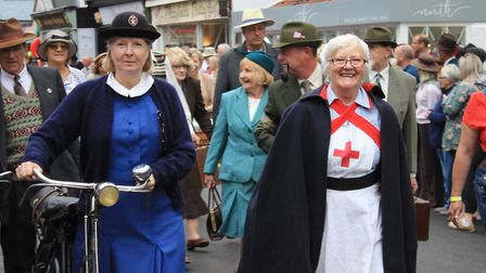 A scene from the Sheringham 1940s weekend civilian parade. Bystanders in costume helped a woman who