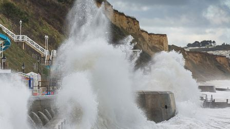 A dramatic image showing waves crashing into the sea wall at Cromer at high tide. Picture: christayl