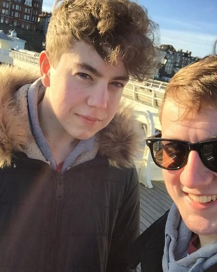 Jess Fairweather, left, with his brother Sam, on Cromer Pier. Picture: COURTESY OF SAM FAIRWEATHER