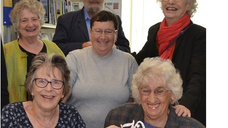 At the 70th anniversary celebration at Wells Library were, back row, from left, Chrissie Farley, dis