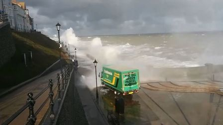 A lorry driver faced a dangerous journey as waves crashed over Cromer's sea wall, onto the esplanade