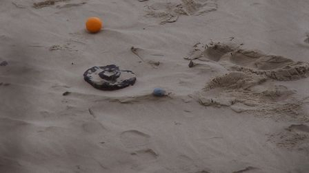 A suspected WW2 bomb was uncovered at Happisburgh beach. The orange was placed there to mark the spo