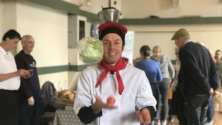 Juggling chef Ian Merchant entertained visitors at Aylsham's Saturday farmers' market. Picture: Ella