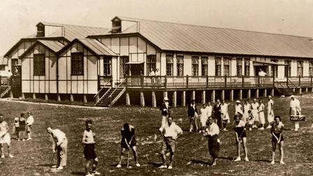 Mundesley holiday camp pavilion pictured with some of its first holidaymakers practising their golf