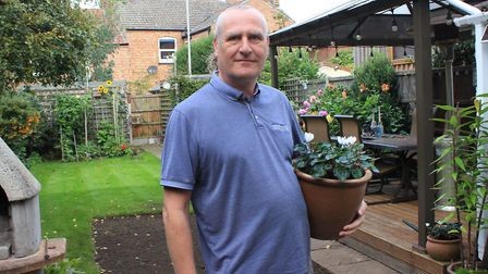 John Austin in his back garden, which is in the process of being re-turfed by Anglian Water contract