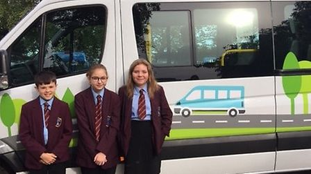 North Norfolk High School students Ryan Ducker, Luci Appleton and Abygayle Turner with the bus they