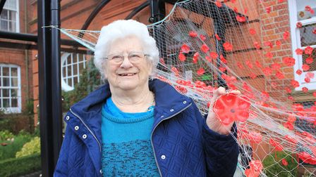 Halsey House day service user Hilda Durrant, 86, with the poppy-themed artwork created by residents