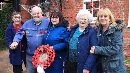 Halsey House staff, residents and volunteers with the poppy-themed artwork they created to mark Reme