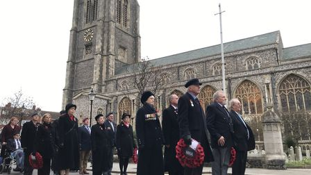 Pausing for thought outside Cromer church at the Remembrance Day commemorations 2019. Picture: Neil