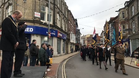 The Remembrance Day parade march through the town on their way to a service at Cromer church. Pictur