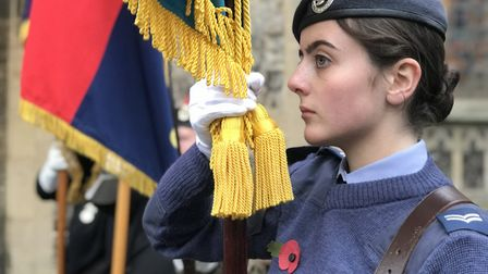 A young Royal Air Force cadet acting as a standard-bearer at the Remembrance Day parade in Cromer. P