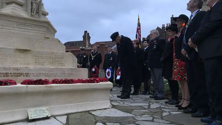 The laying of poppy wreaths at the war memorial after a Remembrance Day service at Cromer church. Pi