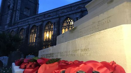 Poppy wreaths laid at the war memorial at Cromer Church for Remembrance Day 2019. Picture: Neil Dids