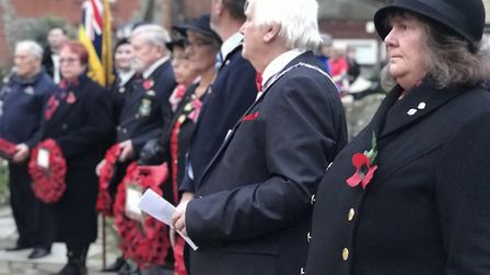 Laying wreaths at the war memorial at Cromer church for Remembrance Day 2019. Picture: Neil Didsbury